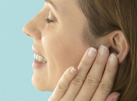 Young Woman with Earache --- Image by © image100/Corbis